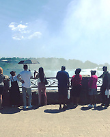 Tourists taking in the view of Niagara Falls on June 28, 2018.