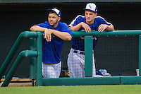 Oklahoma City Dodgers catcher Ralph Henriquez (2) and shortstop Corey Seager (18) in the dugout during the Pacific Coast League baseball game against the Nashville Sounds on June 12, 2015 at Chickasaw Bricktown Ballpark in Oklahoma City, Oklahoma. The Dodgers defeated the Sounds 11-7. (Andrew Woolley/Four Seam Images)