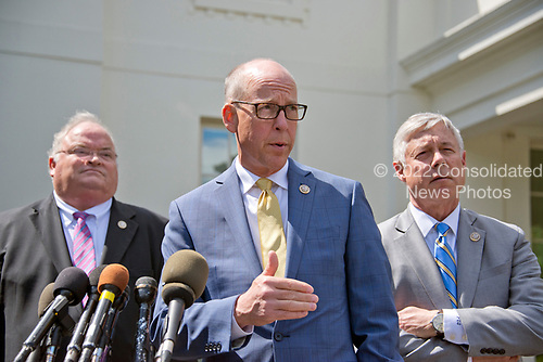 United States Representative Greg Walden (Republican of Oregon), Chairman of the US House Energy and Commerce Committee, announces his support for the GOP health care plan at the White House in Washington, DC following a meeting with US President Donald J. Trump and other members of the Republican Caucus on Wednesday, May 3, 2017.  From left to right: US Representative Billy Long (Republican of Missouri), Chairman Walden, and US Representative Fred Upton (Republican of Michigan).<br /> Credit: Ron Sachs / CNP