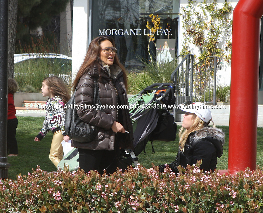 Feb 20th 2012 ..Tia Carrere pushing her kid on the swing at cross creek park in Malibu. Tia ran into Pierce in the parking lot & laughed it up ..AbilityFilms@yahoo.com.805-427-3519.www.AbilityFilms.com.