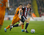 Paul Coutts of Sheffield Utd rampaging past Diogo Jota of Wolverhampton Wanderers during the Championship match at the Bramall Lane Stadium, Sheffield. Picture date 27th September 2017. Picture credit should read: Simon Bellis/Sportimage