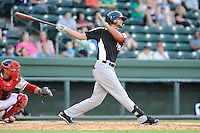 Outfielder Nomar Mazara (12) of the Hickory Crawdads bats in a game against the Greenville Drive on Friday, June 7, 2013, at Fluor Field at the West End in Greenville, South Carolina. Mazara is the No. 16 prospect of the Texas Rangers, according to Baseball America. The catcher is the Drive's Jayson Hernandez. Greenville won the resumption of this May 22 suspended game, 17-8. (Tom Priddy/Four Seam Images)