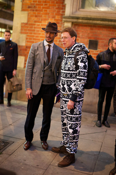 David Gandy stands beside a Damian Whitworth in a onesie at London Collections Mens fashion week