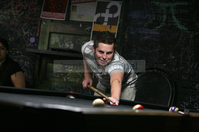 Geology senior Jared Leedy plays pool at Buster's Billiards and Ballroom during Buster's birthday bash September 3, 2010.