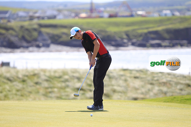 Andrew McCormack (Newcastle West) on the 3rd green during Round 2 of the South of Ireland Amateur Open Championship at LaHinch Golf Club on Thursday 23rd July 2015.<br /> Picture:  Golffile | Thos Caffrey