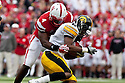 25 November 2011: Linebacker Lavonte David #4 of the Nebraska Cornhuskers tackles wide receiver Keenan Davis #6 of the Iowa Hawkeyes at the Memorial Stadium in Lincoln, Nebraska. Nebraska defeated Iowa 20 to 7.
