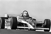 LEXINGTON, OH - SEPTEMBER 11: Mario Andretti drives his Lola T700/Cosworth during practice for the Escort Radar Warning 200 on September 11, 1983, at the Mid-Ohio Sports Car Course near Lexington, Ohio.