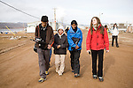 Dhruv (India) an Inuit girl, Shruti (India) and Louise (Germany) walk down the street of Qikiqtarjuaq. Cape Farewell Youth Expedition 08(©Robert vanWaarden ALL RIGHTS RESERVED)