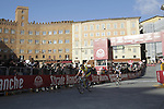 Riders cross the finish line on Il Campo in Siena at the end of the 2014 Strade Bianche race over the white dusty gravel roads of Tuscany running 200km from San Gimignano to Siena, Italy. 8th March 2014.<br /> Picture: Eoin Clarke www.newsfile.ie