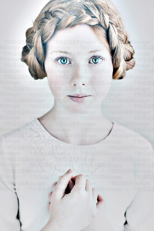 Close up of young girl with braided hair