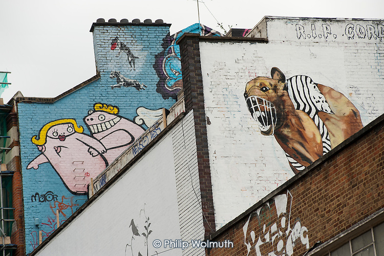 Murals in Shoreditch, London, a run-down commercial district  also known as Silicon Roundabout, which is undergoing gentrification as it becomes a centre for web-based companies and IT start-ups.