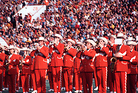 In this vintage 1970 photo The Texas Longhorn Marching Band performs in their characteristic old west western uniform of burnt orange and white with cowboy hats in Memorial Stadium in downtown Austin, Texas. 1970