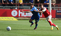 Wimbledon's Ben Purrington and Fleetwood Town's Wes Burns<br /> <br /> Photographer Stephen White/CameraSport<br /> <br /> The EFL Sky Bet League One - Fleetwood Town v AFC Wimbledon - Saturday 4th August 2018 - Highbury Stadium - Fleetwood<br /> <br /> World Copyright &copy; 2018 CameraSport. All rights reserved. 43 Linden Ave. Countesthorpe. Leicester. England. LE8 5PG - Tel: +44 (0) 116 277 4147 - admin@camerasport.com - www.camerasport.com