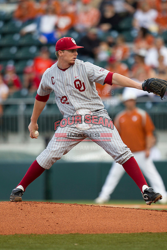 Oklahoma Sooners starting pitcher Jonathan Gray #22 delivers a pitch to the plate against the Texas Longhorns in the NCAA baseball game on April 5, 2013 at UFCU DischFalk Field in Austin Texas. Oklahoma defeated Texas 2-1. (Andrew Woolley/Four Seam Images).