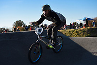"NWA Democrat-Gazette/CHARLIE KAIJO James Stevenson of Rogers rides, Sunday, November 3, 2019 during the Runway Bike Park's first birthday celebration at the Jones Center's Runway Bike Park in Springdale. Stevenson who competed in the Red Bull Pump Track qualifiers in Switzerland last year said he visits the pump track about three times a week said he sees himself in a many of the young people who ride there. ""You get these little kids out here, little dudes like that are not as skilled riders,"" he said tilting his chin towards a young rider taking a tight curve. ""They see us do it and they come up to us and ask how we do it.""<br /> <br /> Riders took to the pump track and bicycle playground to celebrate along with community bike groups Buddy Pegs, Groove Skate Shop and All Bikes All Day NWA"