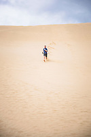 Running down Te Paki Sand Dunes, 90 Mile Beach, New Zealand