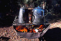 Cowboy coffee brewing over open fire