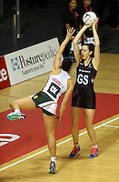 28.07.2015 Silver Ferns Bailey Mes in action during the Silver Fern v South Africa netball test match played at Trusts Arena in Auckland. Mandatory Photo Credit ©Michael Bradley.