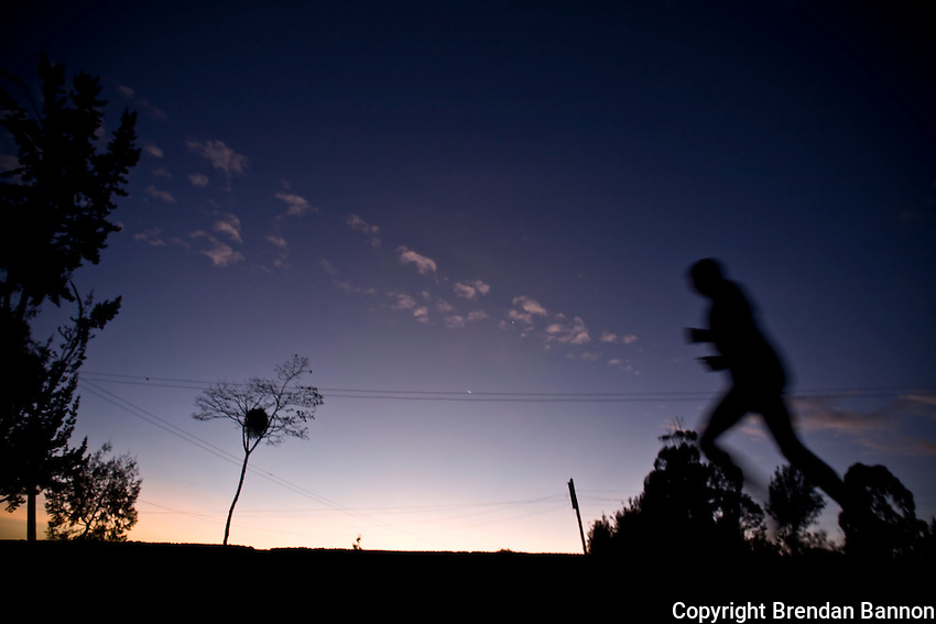 Early morning road work in Iten, Kenya. Iten is a high altitude training ground and has produced hundreds of world class atheltes..For Kenyans running is an industry and offers many  the hope of escaping  grinding poverty.