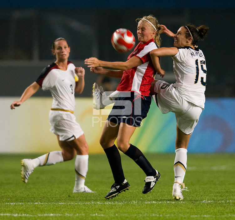 USWNT defender (15) Kate Markgraf boots the ball away from Norwegian forward (8) Solveig Gulbrandsen during first round play for the 2008 Beijing Olympics in Qinhuangdao, China. .  The US lost to Norway, 2-0, at Qinhuangdao Stadium.