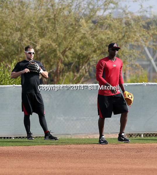 Chris Owings (L), Didi Gregorius (R) of the Arizona Diamondbacks participates in the first day of spring training workouts at Salt River Fields on February 7, 2014 in Scottsdale, Arizona (Bill Mitchell)