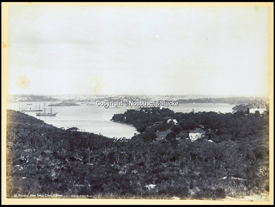 BNPS.co.uk (01202 558833)<br /> Pic: Nosbüsch&Stucke/BNPS<br /> <br /> Sydney from Shell Cove.<br /> <br /> A stunning collection of photographs of Sydney decades before the iconic harbour bridge and opera house were built has been unearthed after 129 years.<br /> <br /> The black and white photo album captures the bustling city centre, picturesque main harbour and famous beaches of the future tourist hot-spot. <br /> <br /> The photos were taken by celebrated Australian photographer Henry King in 1888 who was born in England but emigrated to Australia at a young age and spent the rest of his life there.<br /> <br /> More recently they have fallen into the hands of a German collector who has decided to put them on the market and they are tipped to sell for £1,800.<br /> <br /> Many of Sydney's most recognisable landmarks including Manly beach and Coogee bay look very different to what backpackers would encounter today.<br /> <br /> King also took various photos of Circular Quay - the city's main harbour - but missing from them are images of the Sydney Harbour Bridge and Sydney Opera House as these landmarks were both not built until well into the 20th century.