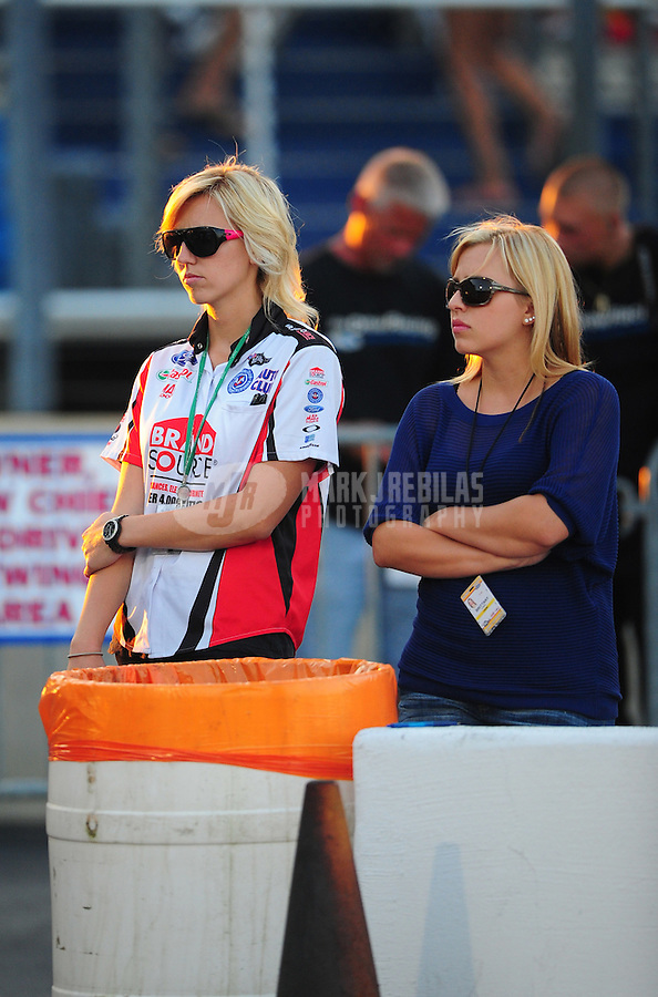 Jul, 8, 2011; Joliet, IL, USA: NHRA driver Courtney Force (left) with sister Brittany Force during qualifying for the Route 66 Nationals at Route 66 Raceway. Mandatory Credit: Mark J. Rebilas-