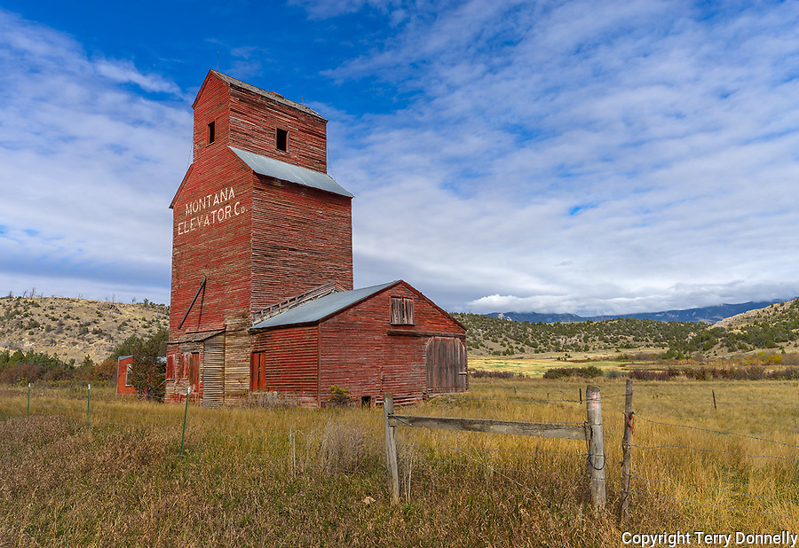 Gallatin County, MT: Old Montana Grain Elevator with afternoon clouds