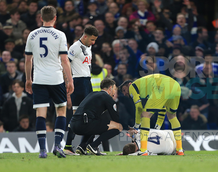Tottenham's Toby Alderweireld goes off injured during the Barclays Premier League match at Stamford Bridge Stadium.  Photo credit should read: David Klein/Sportimage