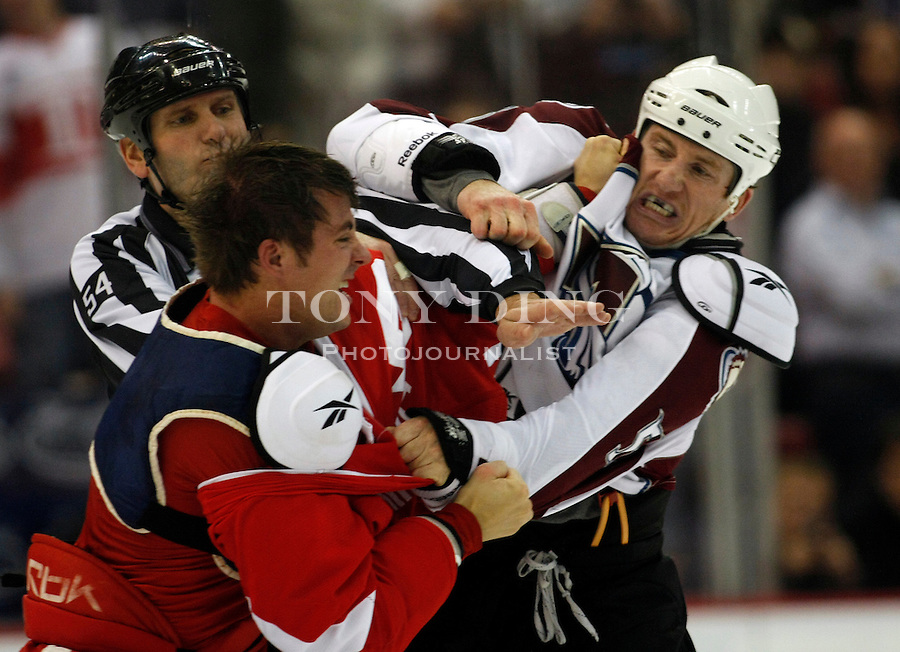 12 October 2010: Detroit Red Wings defenseman Doug Janik, left, fights with Colorado Avalanche forward Cody McLeod (55), in the first period of the Colorado Avalanche at Detroit Red Wings NHL hockey game, at Joe Louis Arena, in Detroit, MI...***** Editorial Use Only *****