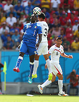 Mario Balotelli of Italy and Giancarlo Gonzalez of Costa Rica in action