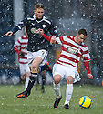 Accies Jon Routledge holds off Raith's Jason Thomson.