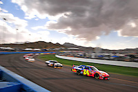 Nov. 9, 2008; Avondale, AZ, USA; NASCAR Sprint Cup Series driver Jeff Gordon (24) leads a pack of drivers during the Checker Auto Parts 500 at Phoenix International Raceway. Mandatory Credit: Mark J. Rebilas-
