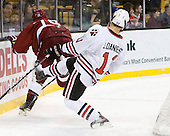 Alex Killorn (Harvard - 19), Justin Daniels (Northeastern - 11) - The Northeastern University Huskies defeated the Harvard University Crimson 4-0 in their Beanpot opener on Monday, February 7, 2011, at TD Garden in Boston, Massachusetts.