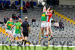 Kevin Gorman  Kilcummin gets ready to puch the ball out of Bryan Sheehan South Kerry hands during their County Championship quarter final in Fitzgerald Stadium on Saturday
