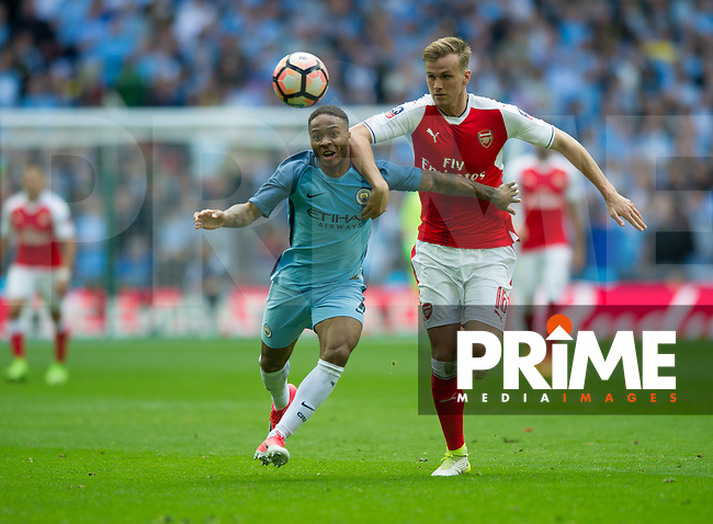 Manchester City Raheem Sterling and Arsenal's Rob Holding during the FA Cup Semi Final match between Manchester City and Arsenal at the Wembley  Stadium, Manchester, England on 23 April 2017. Photo by Andrew Aleksiejczuk / PRiME Media Images.