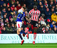 Lincoln City's John Akinde vies for possession with  Crewe Alexandra's Ryan Wintle<br /> <br /> Photographer Andrew Vaughan/CameraSport<br /> <br /> The EFL Sky Bet League Two - Lincoln City v Crewe Alexandra - Saturday 6th October 2018 - Sincil Bank - Lincoln<br /> <br /> World Copyright &copy; 2018 CameraSport. All rights reserved. 43 Linden Ave. Countesthorpe. Leicester. England. LE8 5PG - Tel: +44 (0) 116 277 4147 - admin@camerasport.com - www.camerasport.com
