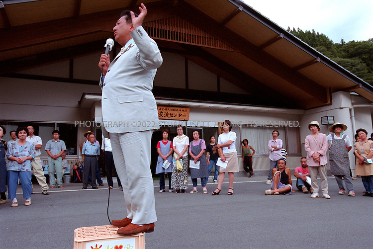 8/26/02--Nagano, Japan..Nagano Gov. Yasuo Tanaka campaigns for reelection on a platform to fight corruption and dam construction...All photographs ©2003 Stuart Isett.All rights reserved.This image may not be reproduced without expressed written permission from Stuart Isett.