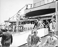 President Roosevelt leaving U.S.S. Target at Jacksonville at conclusion of a fishing trip in March, 1935.<br /> <br /> Photo by Harris & Ewin