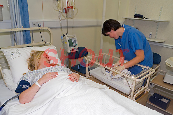 Midwife checking newly born infant after caesarean section birth..©shoutpictures.com.This image may only be used to portray the subject in a positive manner.john@shoutpictures.com