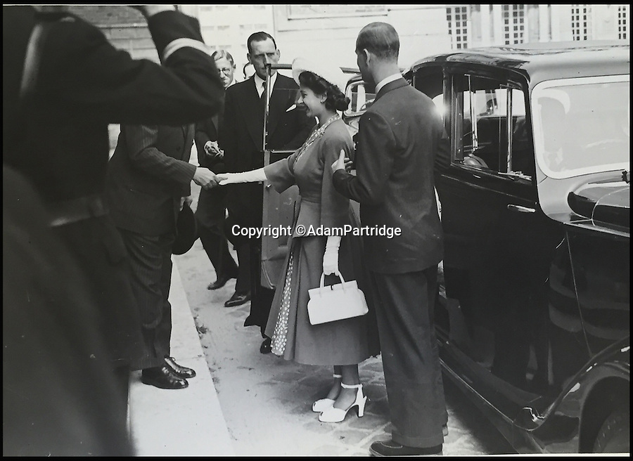 BNPS.co.uk (01202 558833)<br /> Pic: AdamPartridge/BNPS<br /> <br /> A fascinating photo archive that documents the dedication of one of the Queen's bodyguards has come to light 70 years later.<br /> <br /> Police Inspector Alexander Usher was appointed 'No.1 Shadow' to Princess Elizabeth in 1944, when she was aged 18 and 'heir presumptive' to the throne behind her father King George VI.<br /> <br /> Mr Usher served alongside her until 1951, by which time she had married Prince Philip. He even went on their honeymoon.<br /> <br /> The album of photo which he features in is now being sold by Adam Partridge auctioneers.