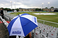 A spectator shelters under an umbrella as rain delays the start of play during Essex CCC vs Middlesex CCC, Specsavers County Championship Division 1 Cricket at The Cloudfm County Ground on 27th June 2017