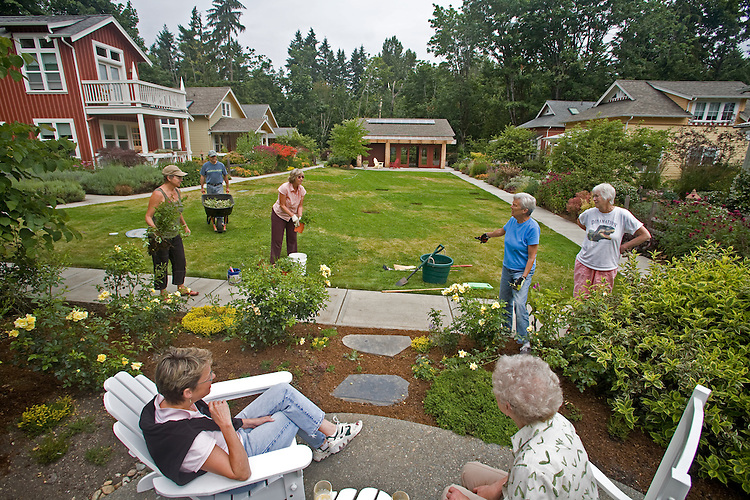 Lifestyle, Residents gather on commons, New Craftsman style cottages, Seattle area, Redmond, Washington, Conover Commons, Development by Cottage Company, Linda Pruitt, Developer, Ross Chapin, Architect,