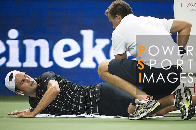 SHANGHAI, CHINA - OCTOBER 13:  Andy Rodick of the United States receives treatment from ATP trainer Michael Novotny before retiring from his match against Stanilas Wawrinka of Switzerland during day three of 2009 Shanghai ATP Masters 1000 at the Qi Zhong Tennis Centre in Shanghai. Photo by Victor Fraile / The Power of Sport Images