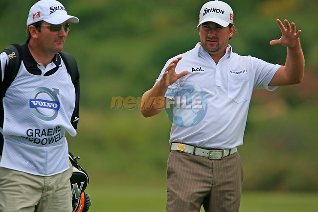 Graeme McDowell (N.IRL) and caddy on the 3rd green during the afternoon session on Day 2 of the Volvo World Match Play Championship in Finca Cortesin, Casares, Spain, 20th May 2011. (Photo Eoin Clarke/Golffile 2011)