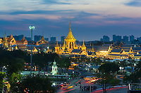 Classic panorama of Bangkok at night - Grand Palace and Sanam luang park golden buddist buildings