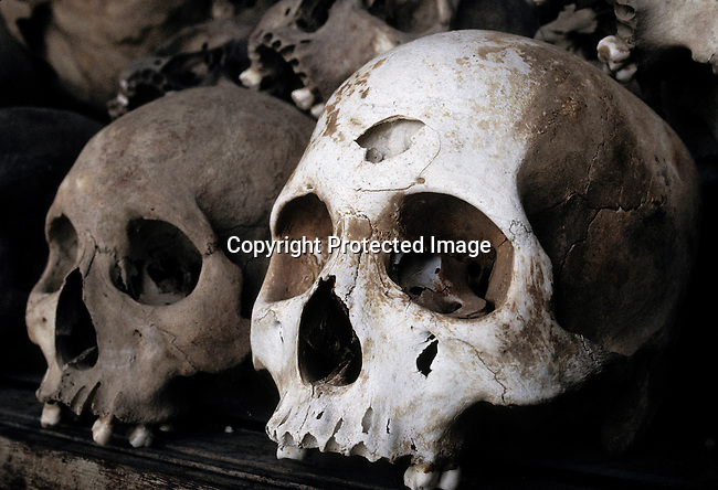 Skulls and remains from 8985 bodies that have been exhumed are displayed at Choeung-Ek (killing fields), a memorial site for victims of the Khmer Rouge regime on March 10, 1998 outside Phnom Penh, Cambodia. From 1975-1979 about 1,7 million people were killed (about 21 percent of the population), in one of the worst human tragedies during recent history. It was led by Pol Pot, who used extremist ideology to repress and murder on a massive scale. (Photo by: Per-Anders Pettersson)