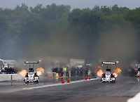 Aug 17, 2014; Brainerd, MN, USA; NHRA top fuel dragster driver Morgan Lucas (left) races alongside Antron Brown during the Lucas Oil Nationals at Brainerd International Raceway. Mandatory Credit: Mark J. Rebilas-