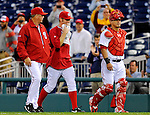 6 September 2011: Washington Nationals pitcher Stephen Strasburg (center), accompanied by pitching coach Steve McCatty and catcher Wilson Ramos, smiles as he walks to the dugout prior to starting against the Los Angeles Dodgers at Nationals Park in Washington, District of Columbia. Strasburg struck out 4, and gave up 2 hits in 5 scoreless innings during his first Major League start since having Tommy John surgery last season. The Dodgers defeated the Nationals 7-3 to take the second game of their 4-game series. Mandatory Credit: Ed Wolfstein Photo