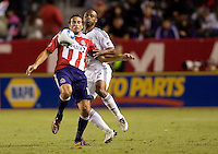 Chivas USA forward Alan Gordon moves with the ball defended tightly by DC United's Julius James. CD Chivas USA beat DC United 1-0 at Home Depot Center stadium in Carson, California on Sunday August 29, 2010.